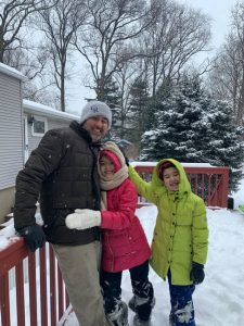 How to Be a Good Parent: Father and kids enjoying fun in snow